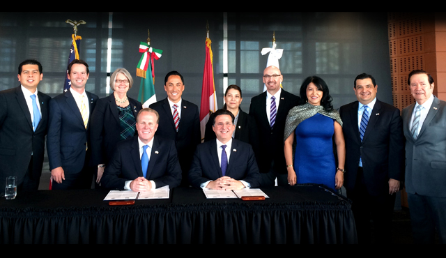 Photo of Mayor Kevin L. Faulconer and Tijuana Mayor Jorge Astiazran flanked by a Delegation of Business Leaders and Government Officials