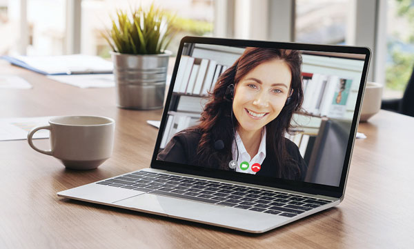 A laptop with a video call in progress